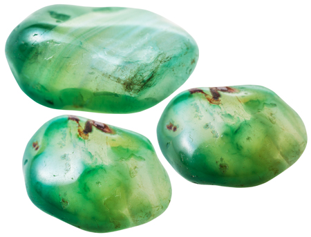 green gemstones: natural mineral gem stone - three green toned agate gemstones isolated on white background close up Stock Photo