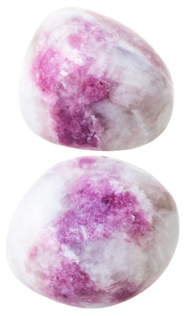 sodalite: natural mineral gem stone - two Pink sodalite gemstone pebbles isolated on white background close up