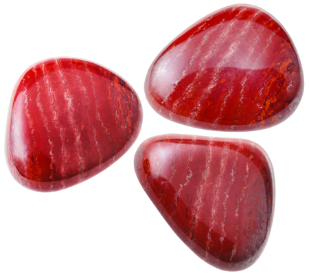 gemmology: natural mineral gem stone - three red Jasper gemstones isolated on white background close up