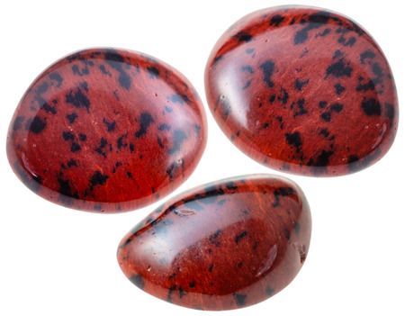 mahogany: natural mineral gem stone - three Mahogany Obsidian gemstones isolated on white background close up