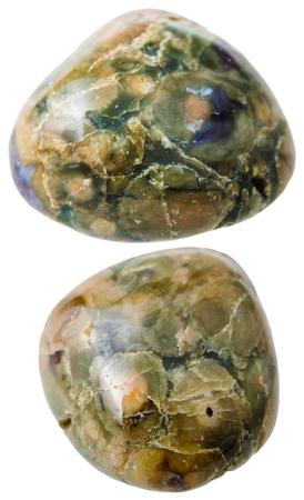 green gemstones: natural mineral gem stone - two Green Rhyolite (Rainforest Jasper) gemstones isolated on white background close up