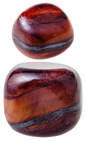 quartzite: natural mineral gem stone - two gems of Jaspillite (jaspilite, ferruginous quartzite) gemstone isolated on white background close up Stock Photo