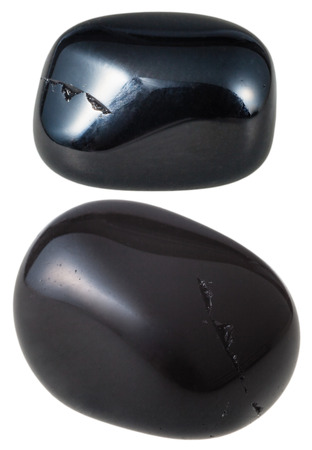 gemology: natural mineral gem stone - two Black Onyx gemstones isolated on white background close up Stock Photo