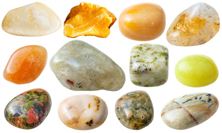green gemstones: natural mineral gem stone - set from 12 pcs yellow, brown and green gemstones isolated on white background