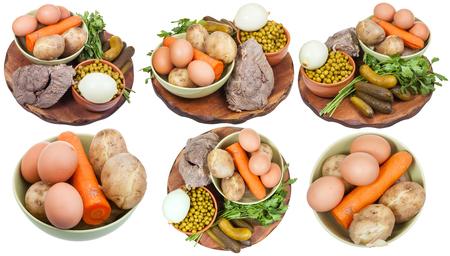 ensalada rusa: establecer con ingredientes cocidos para cocinar ensalada rusa aislado en fondo blanco