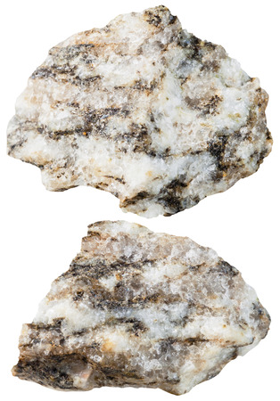 gemology: macro shooting of specimen natural rock - two pieces of Gneiss mineral stone isolated on white background Stock Photo