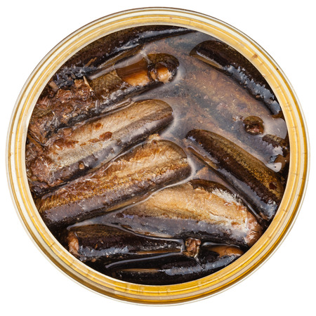 tinned: top view of tinned fish isolated on white background - smoked sprats in oil