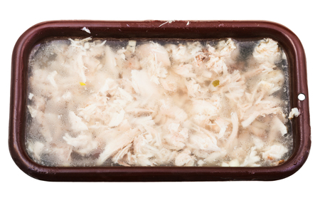 solidify: top view of congealed chicken aspic in brown enameled pan isolated on white background Stock Photo