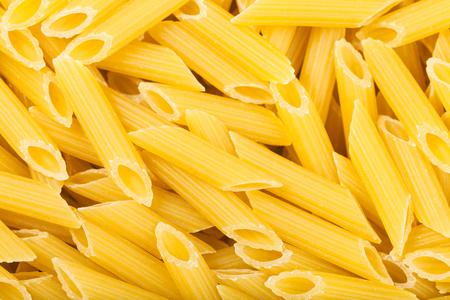 semolina pasta: food background - durum wheat semolina pasta penne rigate