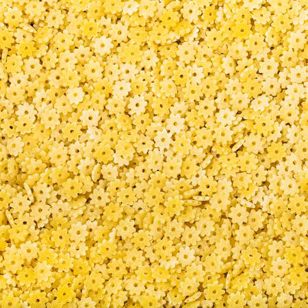 semolina pasta: square food background - durum wheat semolina pasta stelle