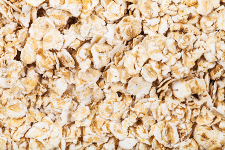 close up food: food background - dry oat flakes close up Stock Photo