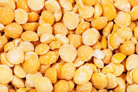 split up: food background - raw yellow split peas close up Stock Photo