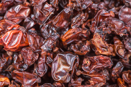 barbery: food background - dried red berberis fruits close up