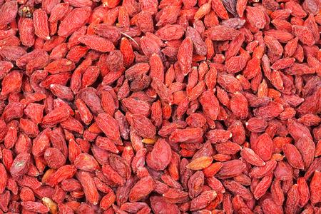 lycium: food background - many dried red goji berries