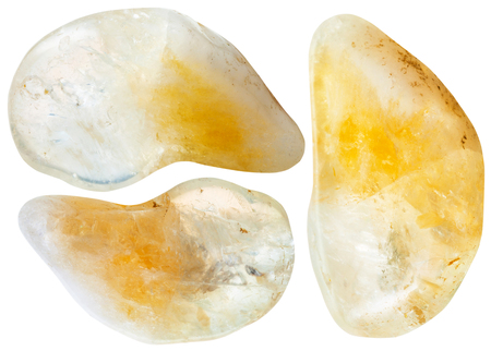 citrine: macro shooting of natural mineral stone - three yellow citrine gemstones isolated on white background