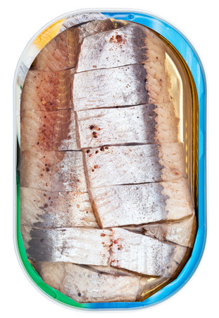 tinned goods: top view of tinned fish isolated on white background - pickled herring in brine