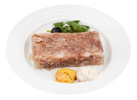 solidify: portion of meat aspic with seasonings on white plate isolated on white background