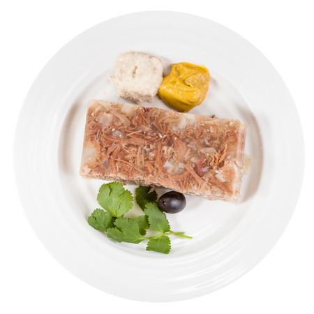 solidify: top view of portion of meat aspic on white plate isolated on white background