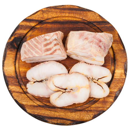 stellate: top view of pieces and slices of hot smoked Starry sturgeon and sturgeon fishes on wooden cutting board isolated on white background