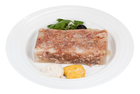 solidify: piece of meat aspic with seasonings on white plate isolated on white background