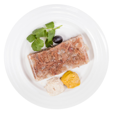 solidify: top view of piece of beef jelly on white plate isolated on white background