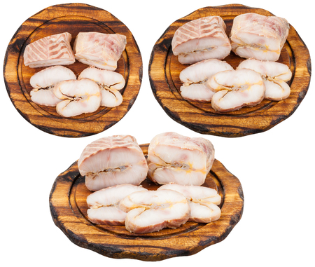 sturgeon: set of wooden boards with hot smoked sturgeon fish isolated on white background Stock Photo
