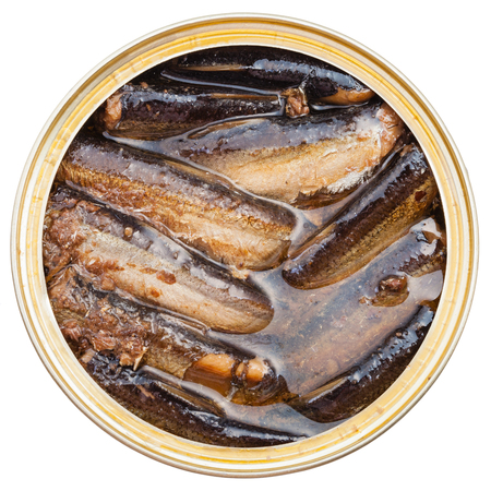 tinned: top view of tinned smoked sprats fish in oil in tin isolated on white background