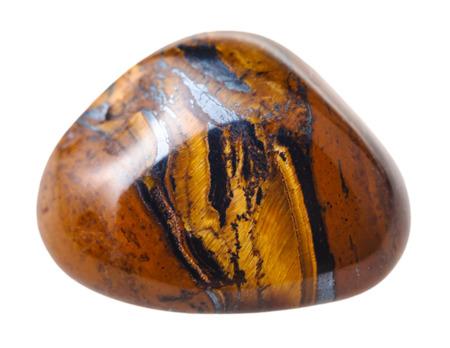 minéral naturel pierre gemme - tigres oeil (oeil de tigre) pierre isolé sur fond blanc close up Banque d'images