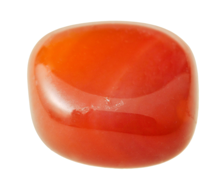 carnelian: natural mineral gem stone - carnelian (cornelian, sard) gemstone isolated on white background close up Stock Photo
