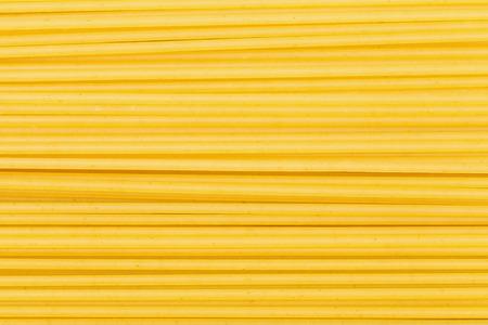 semolina pasta: food background - many durum wheat semolina pasta spaghetti Stock Photo