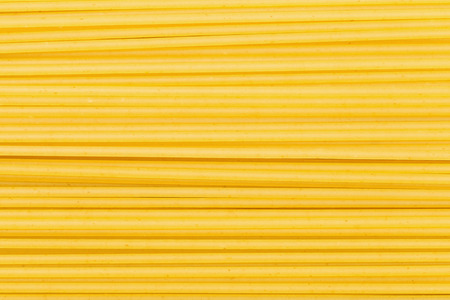 food background - many durum wheat semolina pasta spaghetti Stock Photo