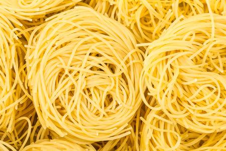 semolina pasta: food background - nests of durum wheat semolina pasta fidelini Stock Photo