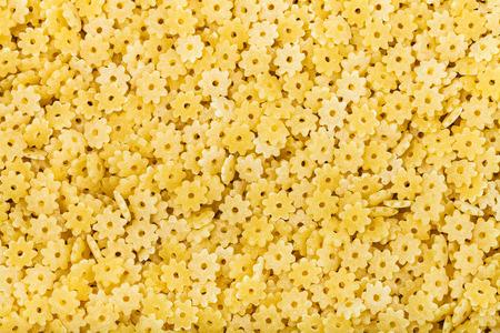 semolina pasta: food background - many durum wheat semolina pasta stelle