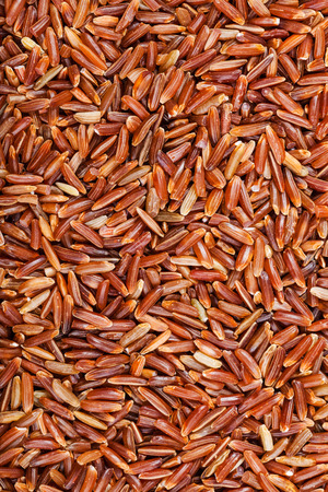 kernel: food background - uncooked long-grain Red Kernel rice Stock Photo