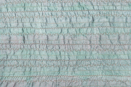 stitched: textile background - handmade stitched green fabric