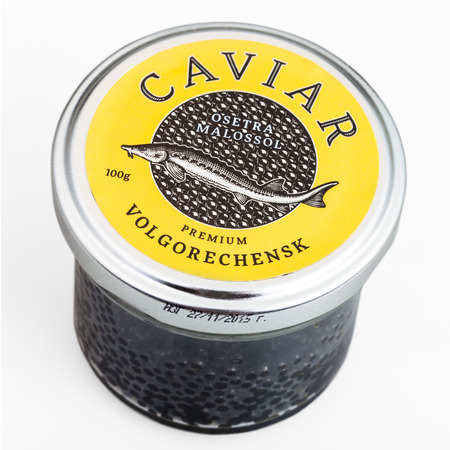 caspian: MOSCOW, RUSSIA - JANUARY 16, 2016: glass jar covered by yellow lid with russian black sturgeon caviar on white background. The main place of production of black caviar is the Caspian Sea.