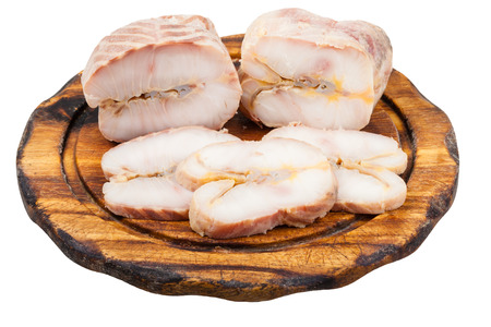 stellate: pieces of hot smoked Starry sturgeon and sturgeon fishes on wooden cutting board isolated on white background Stock Photo