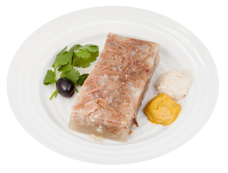 solidify: portion of beef aspic with seasonings on white plate isolated on white background