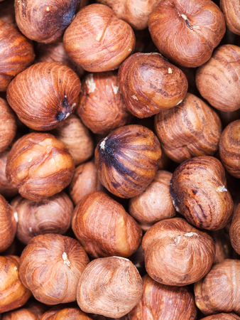 close up food: food background - dried uncooked hazelnuts close up