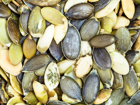 dry cleaned: food background - many green peeled pumpkin seeds Stock Photo