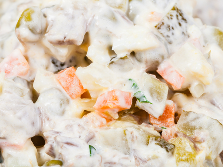 moscovian: olivier russian salad dressed with mayonnaise close up Stock Photo