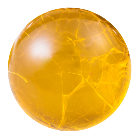 cabochon from yellow fire opal natural mineral gem stone isolated on white background