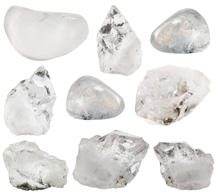 tumbled stones: natural mineral gemstones - various natural rock crystal clear quartz mineral stones and tumbled gems and isolated on white background
