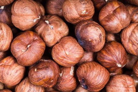 close up food: food background - dried raw hazelnuts close up