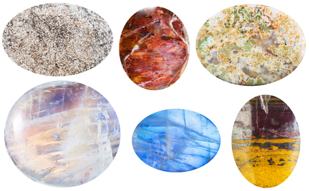 cabochon: macro shooting of collection natural stones - anhydrite, sunstone, moss agate, moonstone, adularia, jaspillite cabochon gem stones isolated on white background