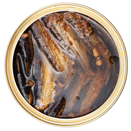 tinned goods: above view of canned fish isolated on white background - smoked sprats in oil