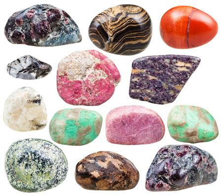 tumbled stones: set of natural mineral tumbled gemstones - baryte, barite, garnet, almandine, alunite, serpentine, serpentinite, rhodonite, red jasper, variscite, thulite, quartz, bronzite stones isolated on white