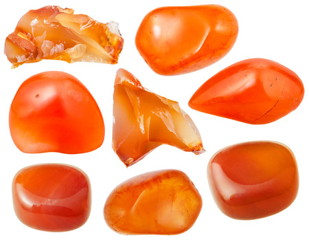 set of natural mineral stones - specimens of carnelian (cornelian, sard) tumbled gemstones and rocks isolated on white background