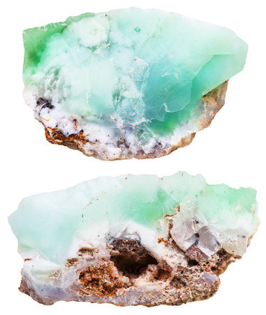 green gemstones: macro shooting of natural mineral stone - two pieces of Chrysoprase (chrysophrase, chrysoprasus, green chalcedony) crystalline gemstones isolated on white background