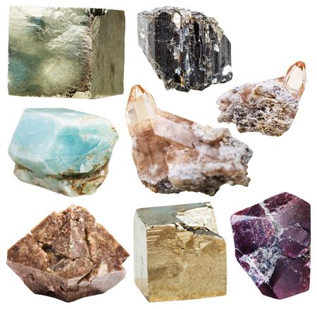 zircon: lot of natural mineral crystal gemstones - apatite, zircon in rock, garnet, almandine, pyrite, schorl (black tourmaline), topaz stones isolated on white background